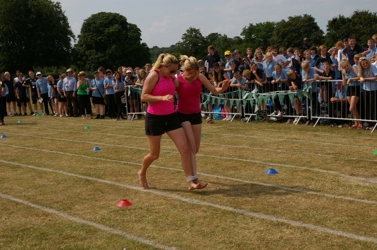 Miss Powell and Mrs Sparrow in the Three-Legged Race